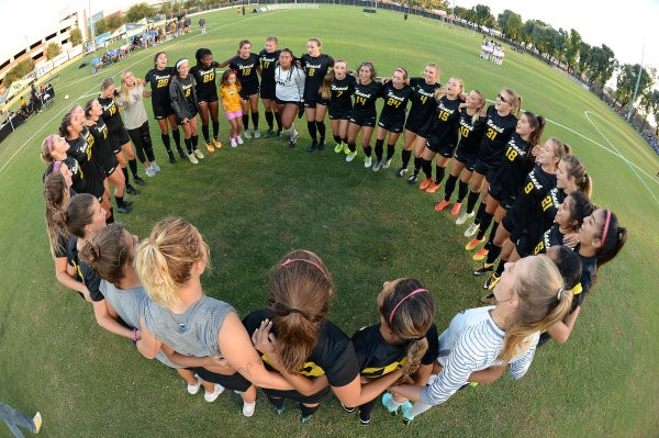 The team huddles up for a pre-match celebration. (Long Beach State Athletics)