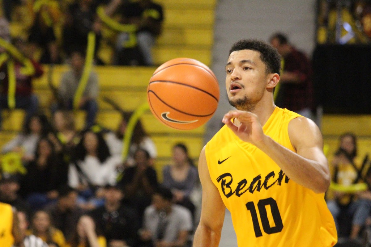 LBSU Men's Basketball player #10 seen passing a ball
